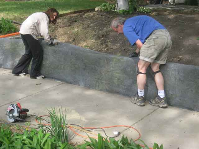 Covering retaining wall with Rock-on-a-roll